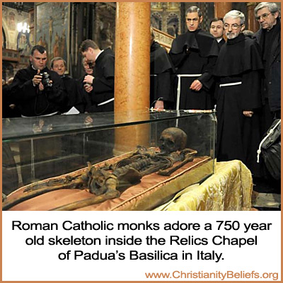 Roman Catholic monks adore a 750 year old skeleton inside the Relics Chapel of Padua's Basilica in Italy