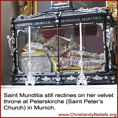 Saint Mudita reclines on her velvet throne at Peterskirche, Stain Peter's Church, in Munich