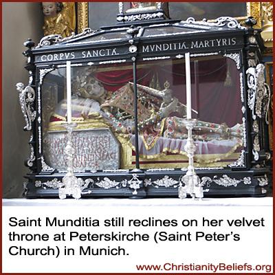 Saint Mudita reclines on her velvet throne at Peterskirche, Stain Peter's Church, in Munich