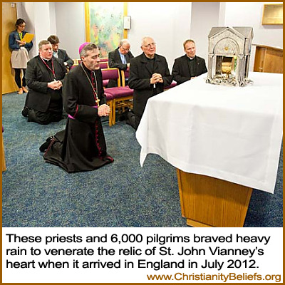 Catholic priests venerate the relic of St. John Vianney's heart in England