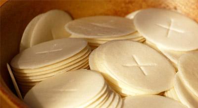 Eucharist wafer T for Tammuz