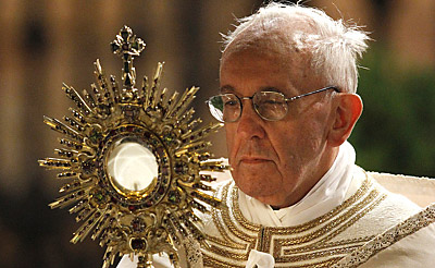 Pope Francis with monstrance that includs sun god wafer on moon goddess cresent moon
