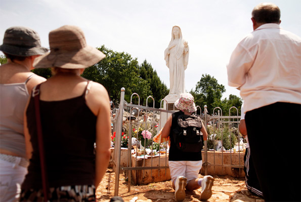 Catholics pray at the site where the Virgin Mary reportedly appeared as an apparition in Medjugorje