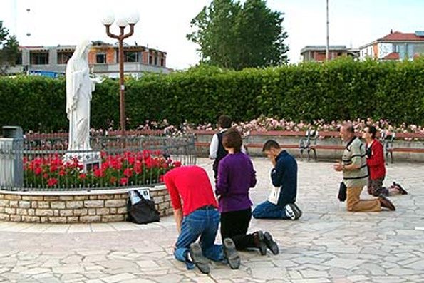 Many Catholic kneel and pray to the Blessed Virgin Mary