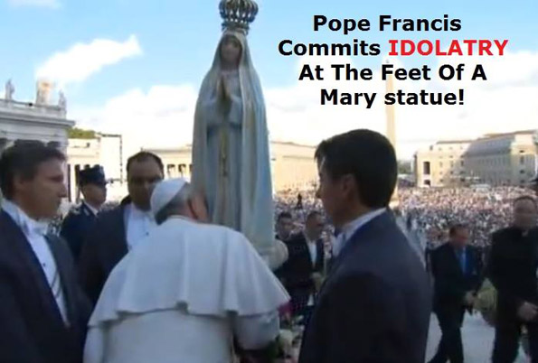 Pope Francis kissing the feet of the Blessed Virgin Mary in St. Peter's Square
