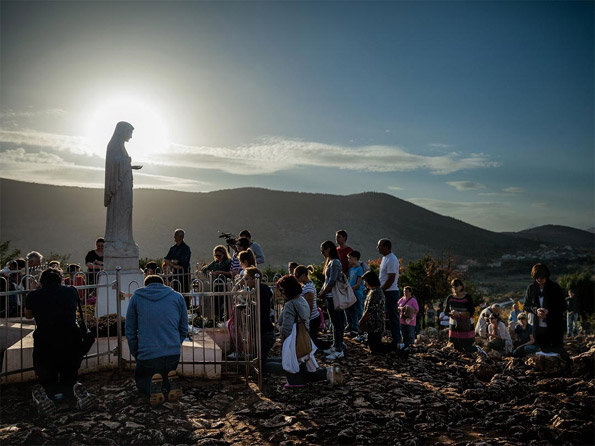 pilgrims visiting Virgin Mary statue at Medjugorje in Bosnia and Herzegovina