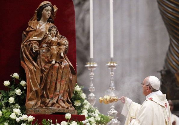 Pope Francis swings incense before the Blessed Virgin Mary